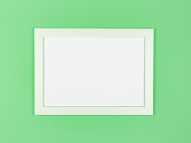 Marco de imagen plano sobre fondo de papel de color pastel con textura