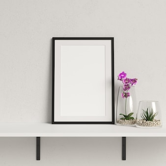 Marco de maqueta en estante blanco con decoración minimalista de la planta