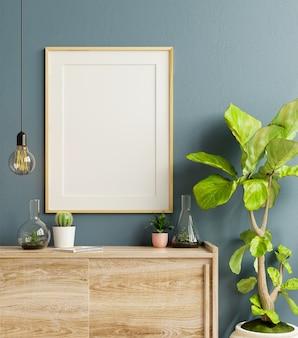 Marco de maqueta en el gabinete en el interior de la sala de estar sobre fondo de pared azul oscuro vacío, renderizado 3d