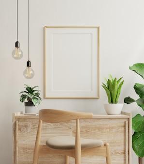 Marco de maqueta en la mesa de trabajo en el interior de la sala de estar sobre fondo de pared blanca vacía, renderizado 3d