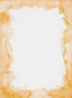 Marco naranja de pinturas sobre hoja blanca.