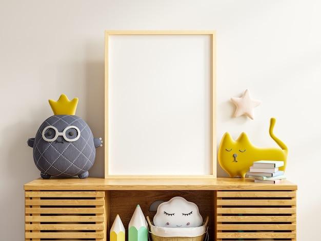 Marco de póster de maqueta en la habitación de los niños con gabinete en fondo de pared de color blanco representación 3d