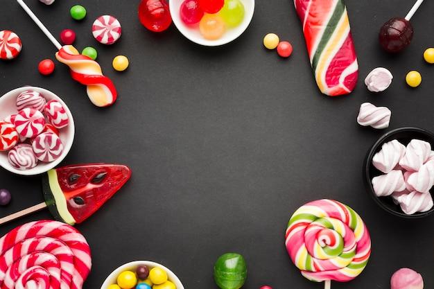 Marco sabroso de dulces con espacio de copia