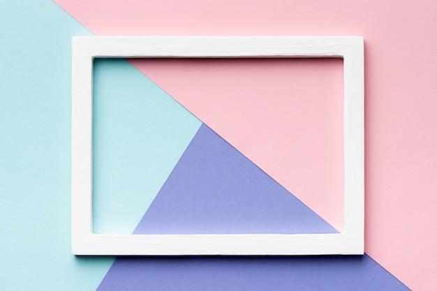 Marco de vista superior sobre fondo de colores