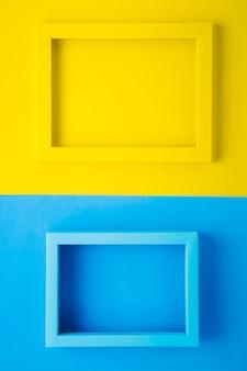 Marcos amarillos y azules sobre fondo bicolor