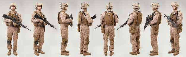 Los marines de los estados unidos obligan a los soldados con rifles en gris rodada en estudio. collage
