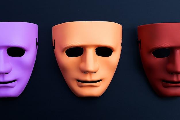 Máscaras faciales sobre superficie oscura. vista superior