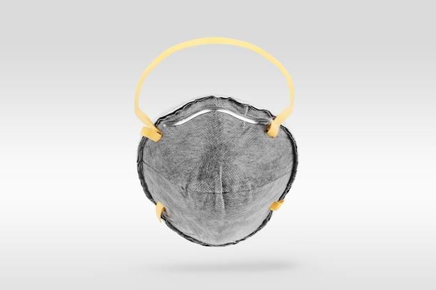 Mascarilla anti contaminación sobre fondo gris
