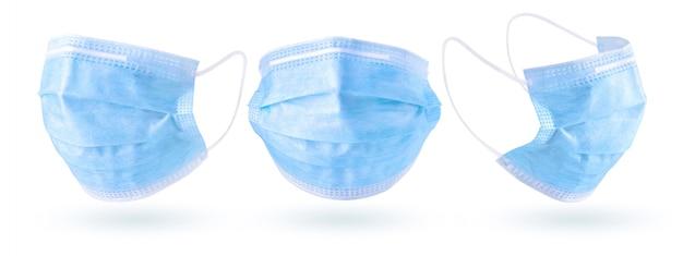 Mascarilla quirúrgica para protección contra bacterias y enfermedad por coronavirus aislada en blanco con trazado de recorte