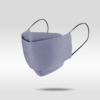 Mascarilla de tela azul violáceo claro sobre gris