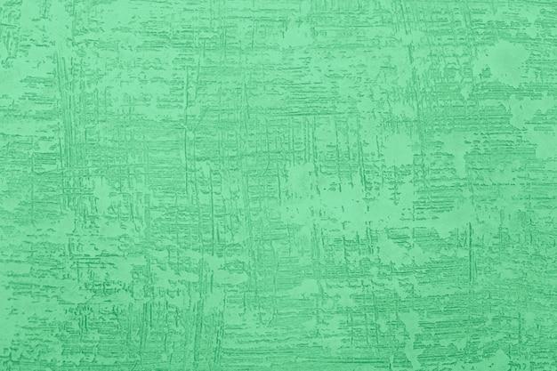 Masilla con textura en la pared. fondo de pared áspera grunge.