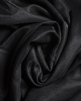 Material elegante negro de seda con curvas