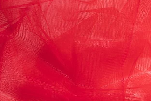 Material de tela roja transparente para decoración interior.