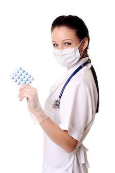 Médico - aquí tienes que tomar tus pastillas.
