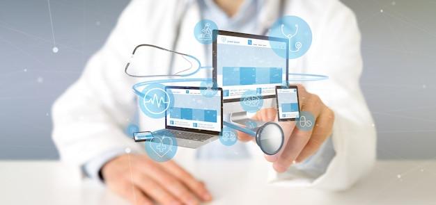 Médico sosteniendo dispositivos con ícono médico y representación 3d estetoscopio