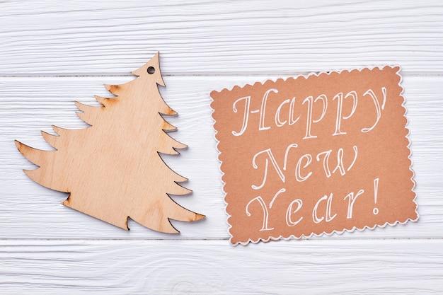 Mensaje y árbol de navidad de madera.