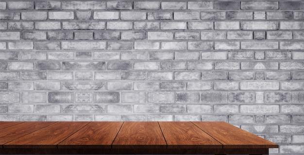 Mesa de madera delante de la pared de ladrillo desenfoque de fondo.