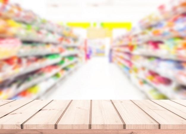 Mesa de madera o piso de madera con fondo borroso de supermercado para exhibición de productos