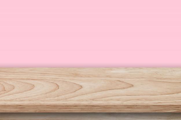 Mesa de madera vacía y textura de fondo de pared rosa, montaje de pantalla con espacio de copia.