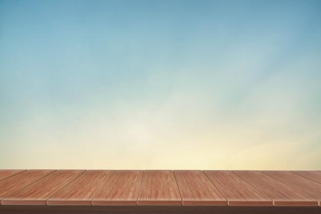 Mesa de madera con vista azul como telón de fondo. se puede utilizar para mostrar productos.