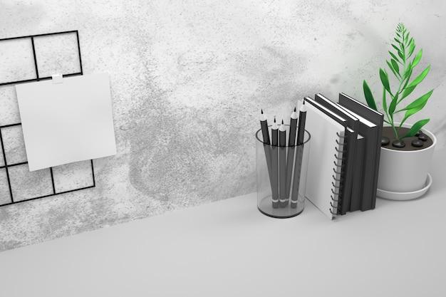 Mesa de oficina con lápices, libros y macetas