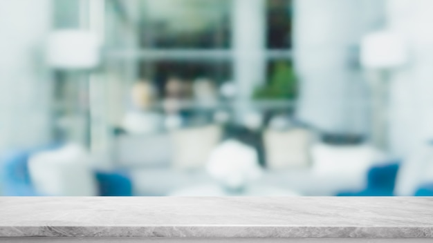 La mesa de piedra de mármol blanco vacía y la ventana de cristal borrosa en el interior del restaurante se burlan del fondo abstracto: se pueden usar para mostrar o montar sus productos.