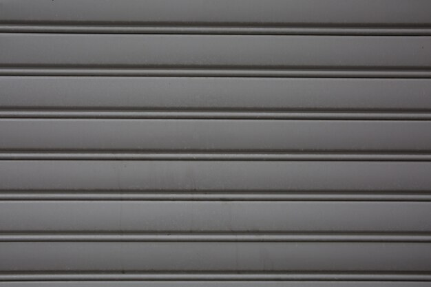 Metal de fondo, puerta metálica plana cepillada