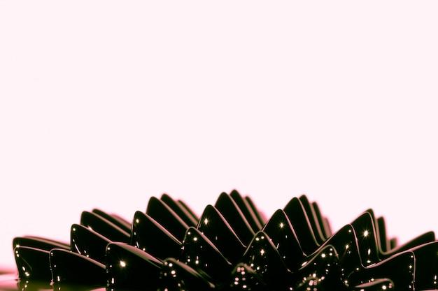 Metal líquido ferromagnético negro con espacio de copia