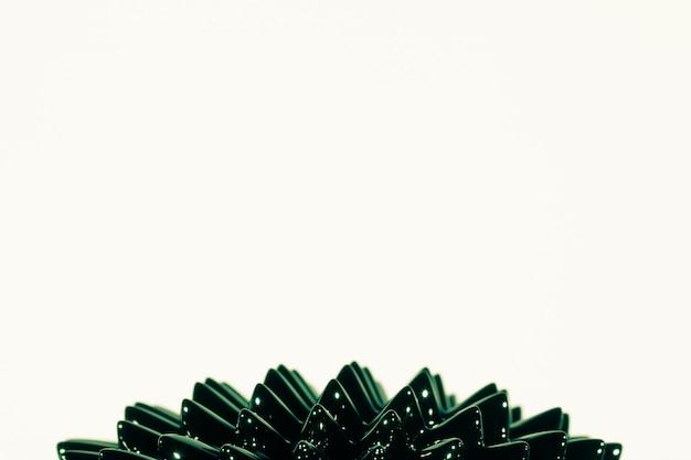 Metal líquido ferromagnético verde con espacio de copia