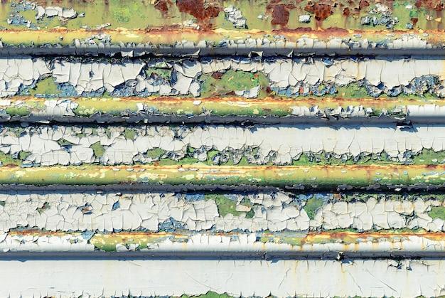 Metal pintado oxidado agrietado verde