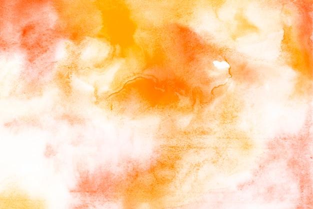 Mezcla de pintura amarilla y naranja