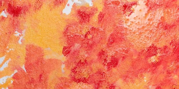 Mezcla de pintura roja y naranja