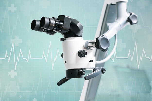 Microscopio eléctrico con fondo verde azulado