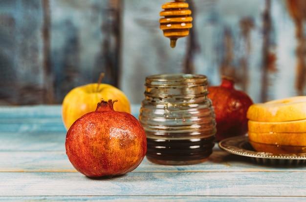 Miel, manzana y granada símbolos festivos tradicionales rosh hashanah jewesh holiday