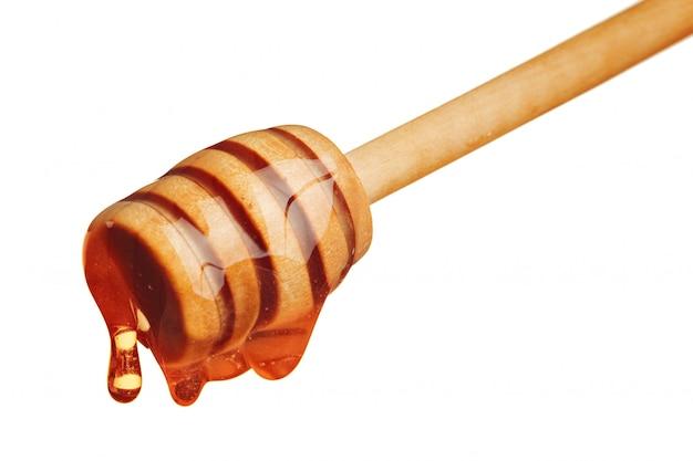 Miel y panal con palo de madera