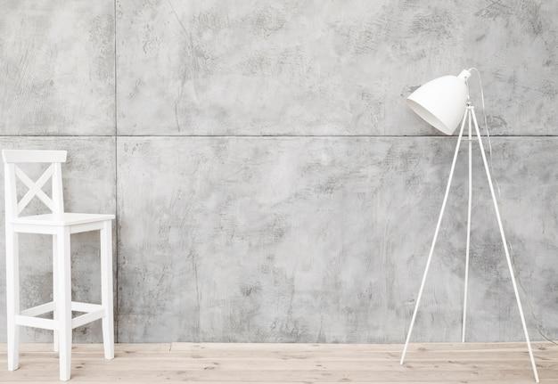Minimalista lámpara de pie blanca y taburete con paneles de hormigón.