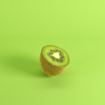 Mitad de la fruta de kiwi verde fresca madura aislada en fondo verde