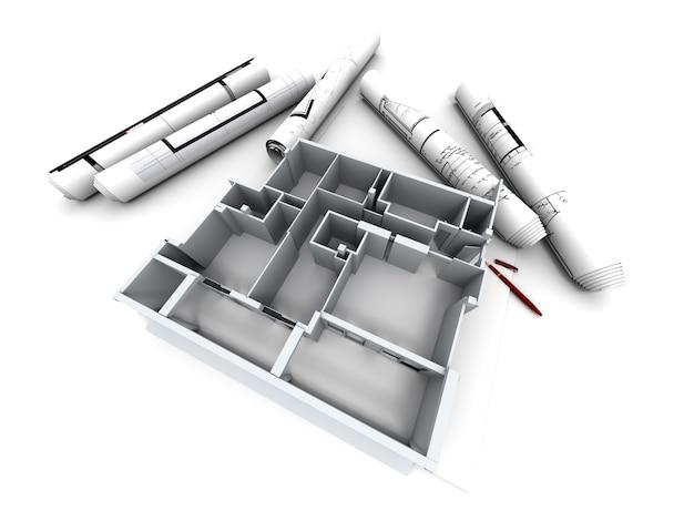 Modelo arquitectónico de la casa de un diseñador con planos enrollados.
