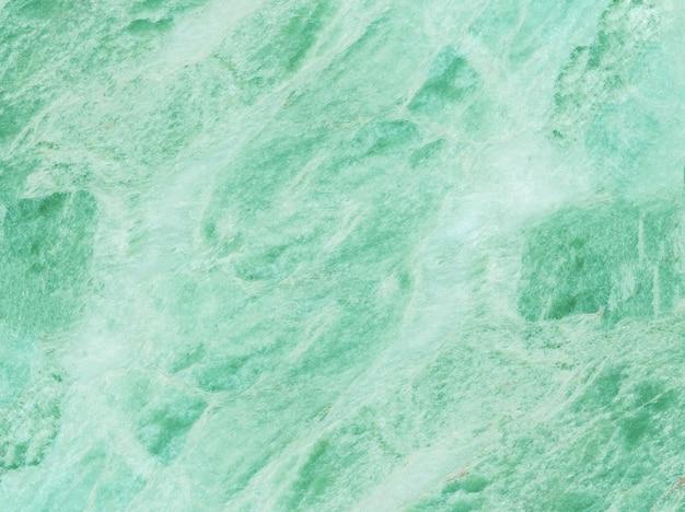 El modelo de mármol superficial del primer en la pared de piedra de mármol verde texturizó el fondo