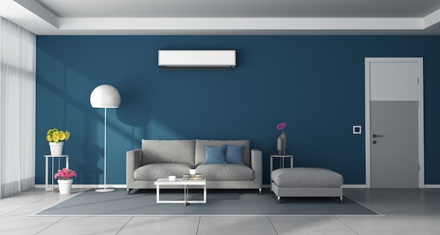 Moderna sala azul con muebles grises y aire acondicionado.