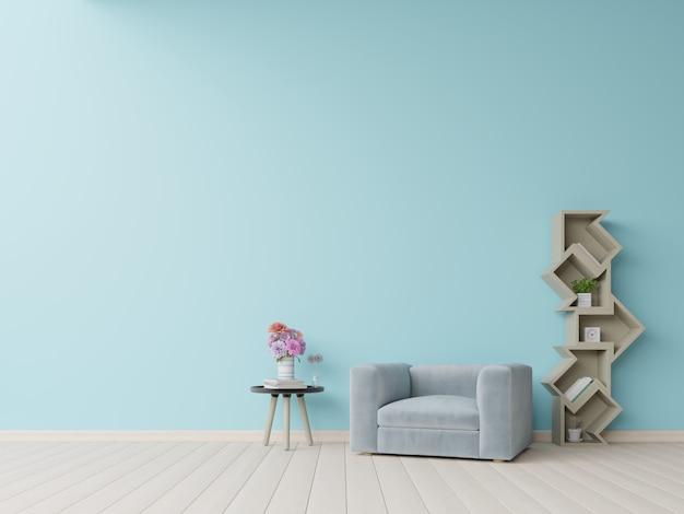 La moderna sala de estar con sillón azul tiene gabinete y lámpara en el piso de madera y la pared azul.