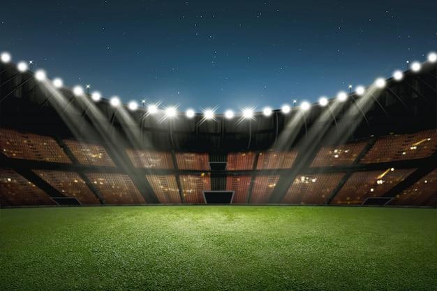 Moderno edificio de estadio de fútbol con iluminación.