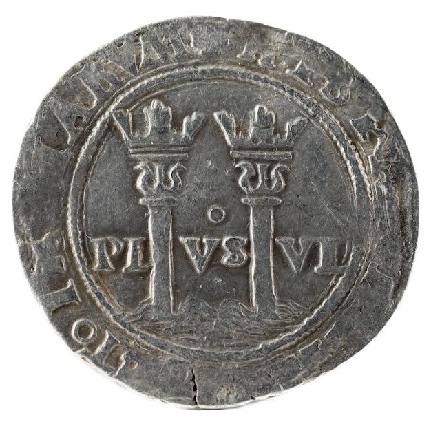 Moneda de plata antigua española de los reyes juana y carlos.