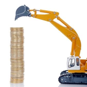 Monedas de euro dinero con excavadora