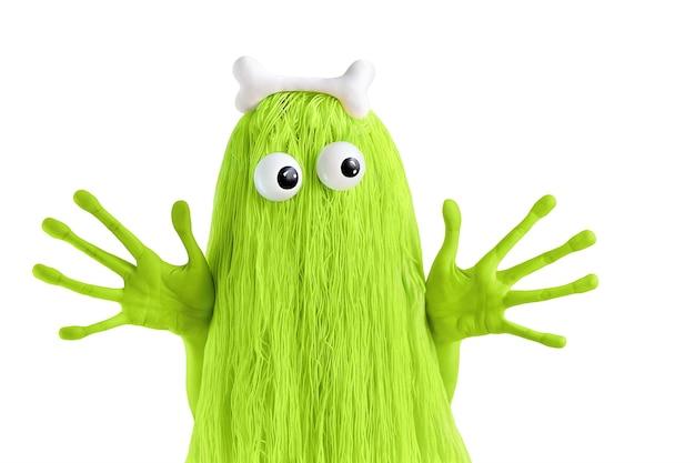 Monstruo verde con ojos grandes, manos grandes y hueso en la cabeza.