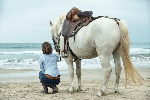 Montar mujer y caballo