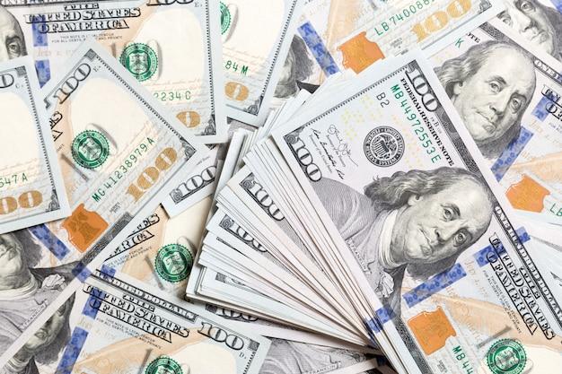 Montón de billetes de dólar estadounidense, fondo de dinero