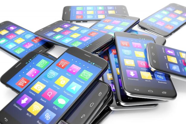 Montón de los diferentes smartphones con aplicación en la pantalla.
