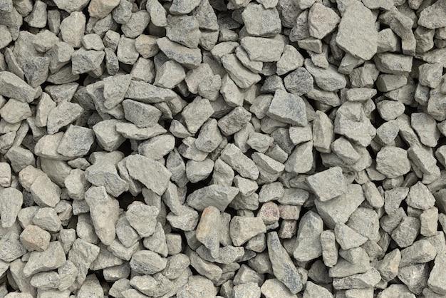 Montón de piedra triturada o roca angular como textura o fondo