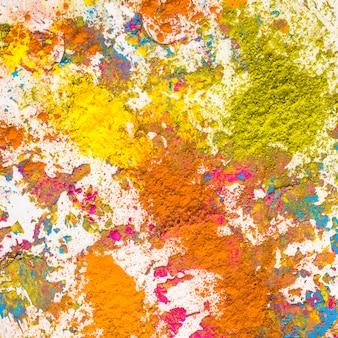Montones de naranja, amarillo y mostaza de colores secos.